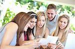Friends looking at pictures together Stock Photo - Premium Royalty-Free, Artist: CulturaRM, Code: 614-06537614