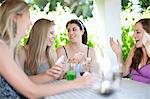 Women playing cards at table Stock Photo - Premium Royalty-Freenull, Code: 614-06537632