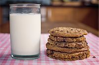 Stack of chocolate chip cookies and milk Stock Photo - Premium Royalty-Freenull, Code: 614-06537660