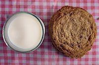 Stack of chocolate chip cookies and milk Stock Photo - Premium Royalty-Freenull, Code: 614-06537661