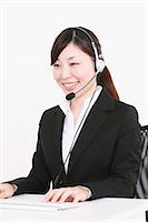 switchboard operator - Businesswoman with headset Stock Photo - Premium Rights-Managednull, Code: 859-06537890