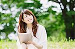 Young woman with tablet Stock Photo - Premium Rights-Managed, Artist: Aflo Relax, Code: 859-06538065