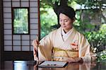 Woman in a kimono practicing calligraphy Stock Photo - Premium Rights-Managed, Artist: Aflo Relax, Code: 859-06538328