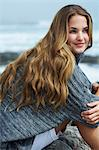 Beautiful young woman sitting by ocean Stock Photo - Premium Rights-Managed, Artist: urbanlip.com, Code: 847-06540549