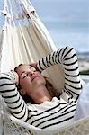 Beautiful young woman relaxing in hammock Stock Photo - Premium Rights-Managed, Artist: urbanlip.com, Code: 847-06540561