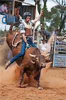 Australia, Queensland, Mt Garnet.  Bull rider in action at Mt Garnet Rodeo. Stock Photo - Premium Rights-Managednull, Code: 862-06540746