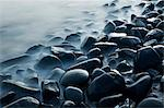 Australia, Queensland, Cairns.  Waves lapping rocks at Pebbly Beach. Stock Photo - Premium Rights-Managed, Artist: AWL Images, Code: 862-06540767