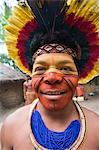 Brazil, Bahia, Porto Seguro, Pataxo indigenous man wearing a feather headdress in the Jaqueira Pataxo Reservation Stock Photo - Premium Rights-Managed, Artist: AWL Images, Code: 862-06540804