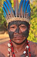South America, Brazil, Miranda, Terena indigenous man from the Pantanal in a Macaw feather headdress Stock Photo - Premium Rights-Managednull, Code: 862-06540982