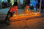 South America, Colombia, Leticia, Amazon region, Kids lighting candles along a street Stock Photo - Premium Rights-Managed, Artist: AWL Images, Code: 862-06541019