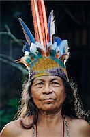 Indian woman with head dress, Ticuna Indian Village of Macedonia, Amazon River, near Puerto Narino, Colombia Stock Photo - Premium Rights-Managednull, Code: 862-06541044