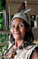 Indian woman with dead dress, Ticuna Indian Village of Macedonia, Amazon River, near Puerto Narino, Colombia Stock Photo - Premium Rights-Managednull, Code: 862-06541045