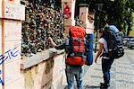 backpackers looking at Love Locks, Prague, Czech Republic, Europe Stock Photo - Premium Rights-Managed, Artist: AWL Images, Code: 862-06541210