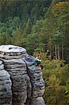 Czech Republic, Bohemia, Prahovskie Region, A mountain climber on one of the hills at the Prahovskie Skali nature reseve. Unesco tentative list Stock Photo - Premium Rights-Managed, Artist: AWL Images, Code: 862-06541242