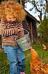 Bedfordshire, England. A little girl feeds the chickens while glamping. MR Stock Photo - Premium Rights-Managed, Artist: AWL Images, Code: 862-06541366