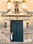 France, Provence, Arles, Notra Dame de la Major, Woman taking photograph in church doorway. MR Stock Photo - Premium Rights-Managed, Artist: AWL Images, Code: 862-06541484