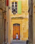 France, Provence, Arles, girl with Baguette at doorway MR Stock Photo - Premium Rights-Managed, Artist: AWL Images, Code: 862-06541490