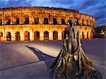 France, Provence, Nimes,  Roman ampitheatre, Toreador statue at dusk Stock Photo - Premium Rights-Managed, Artist: AWL Images, Code: 862-06541538