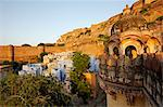 India, Rajasthan, Jodhpur. The houses of Jodhpurs old quarter almost touch the outer fortifying walls of the citys massive Mehrangarh Fort. Stock Photo - Premium Rights-Managed, Artist: AWL Images, Code: 862-06541957