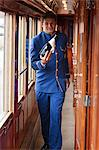 A steward on the Venice Simplon Orient Express train, bringing champagne to guests on board, Italy Stock Photo - Premium Rights-Managed, Artist: AWL Images, Code: 862-06542153