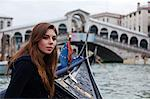 A young tourist enjoying the sights of Venice, with the Rialto Bridge in the background, Italy Stock Photo - Premium Rights-Managed, Artist: AWL Images, Code: 862-06542161