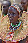 A young Pokot woman sings to celebrate the opening of a new pre primary school at Ngaini, a remote area of the Kerio Valley. Despite her youth, her jewellery denotes she is already married. Stock Photo - Premium Rights-Managed, Artist: AWL Images, Code: 862-06542264