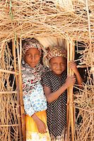 Merti, Northern Kenya. Two children peer from the door of their home. Stock Photo - Premium Rights-Managed, Artist: AWL Images, Code: 862-06542285