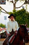 Seville, Andalusia, Spain, A Spanish girl in Traditional Andalusian clothes riding a horse during the Feria de Abril Stock Photo - Premium Rights-Managed, Artist: AWL Images, Code: 862-06542817