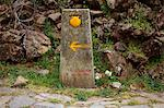 Spain, Galicia, Camino Frances, A typical stone sign on the camino with the shell, indicating the direction and distance from Santiago Stock Photo - Premium Rights-Managed, Artist: AWL Images, Code: 862-06542830