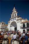 El Rocio, Huelva, Southern Spain. Man in traditional clothes on horseback in front of the main church in the village of El Rocio during the annual Romeria Stock Photo - Premium Rights-Managed, Artist: AWL Images, Code: 862-06542968