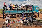 At the conclusion of a market near Puranga, the stallholders pack up their wares in sacks and takes them home by lorry, Uganda, Africa Stock Photo - Premium Rights-Managed, Artist: AWL Images, Code: 862-06543135