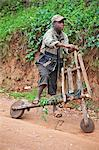 A young boy with his homemade wooden bicycle, Uganda, Africa Stock Photo - Premium Rights-Managed, Artist: AWL Images, Code: 862-06543260