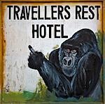 A hotel sign for the Travellers Rest Hotel in Kisoro denotes its connection with Mountain Gorillas, Uganda, Africa Stock Photo - Premium Rights-Managed, Artist: AWL Images, Code: 862-06543276