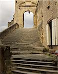 stone stairs leading to archway, with grey cloudy sky, old medieval stone architecture in the small village of Saint-Antoine-l'Abbaye, France Stock Photo - Premium Rights-Managed, Artist: Michael Mahovlich, Code: 700-06543489