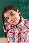 Head and Shoulders Portrait of Girl in front of Chalkboard in Classroom Stock Photo - Premium Royalty-Free, Artist: Uwe Umsttter, Code: 600-06543524