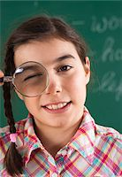 preteen girl - Close-up of Girl with Magnifying Glass in Classroom Stock Photo - Premium Royalty-Freenull, Code: 600-06543525