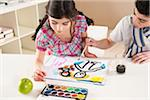 Girl and Boy Painting in Classroom Stock Photo - Premium Royalty-Free, Artist: Uwe Umsttter, Code: 600-06543551