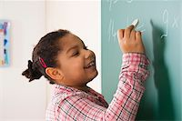 Girl Answering Question at Blackboard in Classroom, Baden-Wurttemberg, Germany Stock Photo - Premium Royalty-Freenull, Code: 600-06548568
