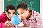 Portrait of Girls Looking at Globe in Classroom, Baden-Wurttemberg, Germany Stock Photo - Premium Royalty-Free, Artist: Uwe Umstätter, Code: 600-06548576