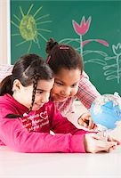 Portrait of Girls Looking at Globe in Classroom, Baden-Wurttemberg, Germany Stock Photo - Premium Royalty-Freenull, Code: 600-06548577