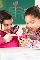Portrait of Girls Looking at Flower in Classroom, Baden-Wurttemberg, Germany Stock Photo - Premium Royalty-Freenull, Code: 600-06548578