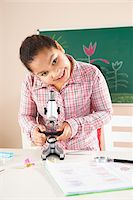 Girl Looking at Flower with Microscope in Classroom, Baden-Wurttemberg, Germany Stock Photo - Premium Royalty-Freenull, Code: 600-06548585