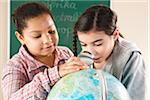 Portrait of Girls Looking at Globe in Classroom, Baden-Wurttemberg, Germany Stock Photo - Premium Royalty-Free, Artist: Uwe Umstätter, Code: 600-06548597