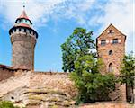 Low Angle View of Nuremberg Imperial Castle with Blue Sky and Clouds, Kaiserburg, Nuremberg, Middle Franconia, Bavaria, Germany Stock Photo - Premium Rights-Managed, Artist: Siephoto, Code: 700-06553330
