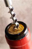 Close-up of Corkscrew Opening Bottle of Wine Stock Photo - Premium Royalty-Freenull, Code: 600-06553491