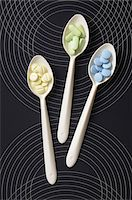 Overhead View of Pills on Spoons Stock Photo - Premium Royalty-Freenull, Code: 600-06553515