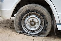 Deflated damaged tyre on white car wheel Stock Photo - Royalty-Freenull, Code: 400-06555514