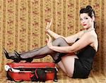 Feminine Pin Up Girl in Studio With Luggage Stock Photo - Royalty-Free, Artist: tobkatina                     , Code: 400-06556159
