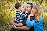 Happy Mixed Race Ethnic Family Having Fun Playing In The Park. Stock Photo - Royalty-Free, Artist: Feverpitched                  , Code: 400-06557384