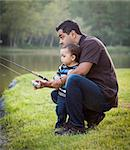 Happy Young Ethnic Father and Son Fishing at the Lake. Stock Photo - Royalty-Free, Artist: Feverpitched                  , Code: 400-06557387